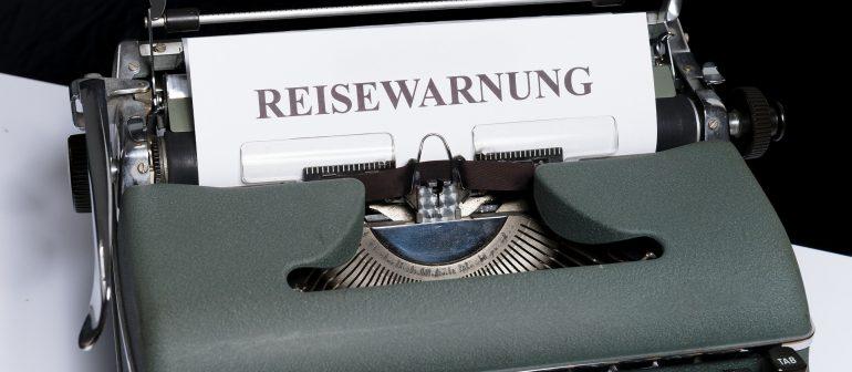 Reisewarnung-Schreibmaschine